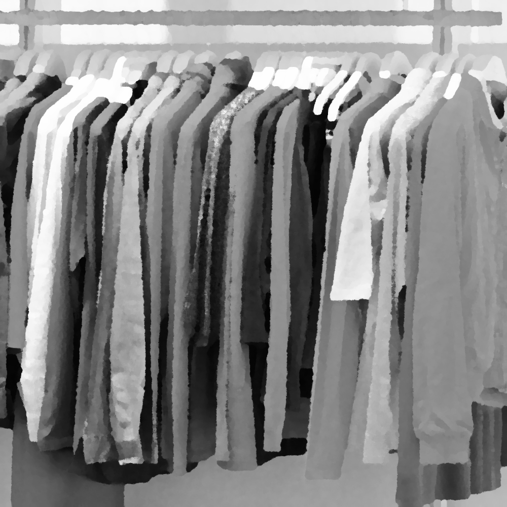 Different clothing articles, hung up on a rack