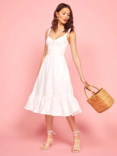 A white midi dress with a minimal sweetheart neckline and a fitted bodice. Great for soft classics!