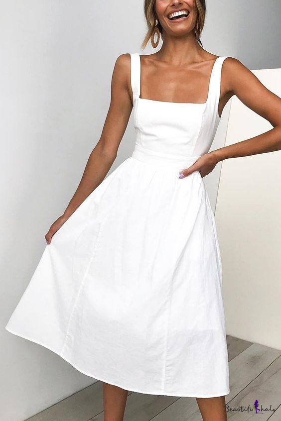 A minimal white midi dress made from slightly stiff fabric, with a square neckline. Great for dramatic classics!