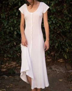 A white linen maxi dress, with sharp sleeves, and buttons going down the middle of it. Great for dramatics!