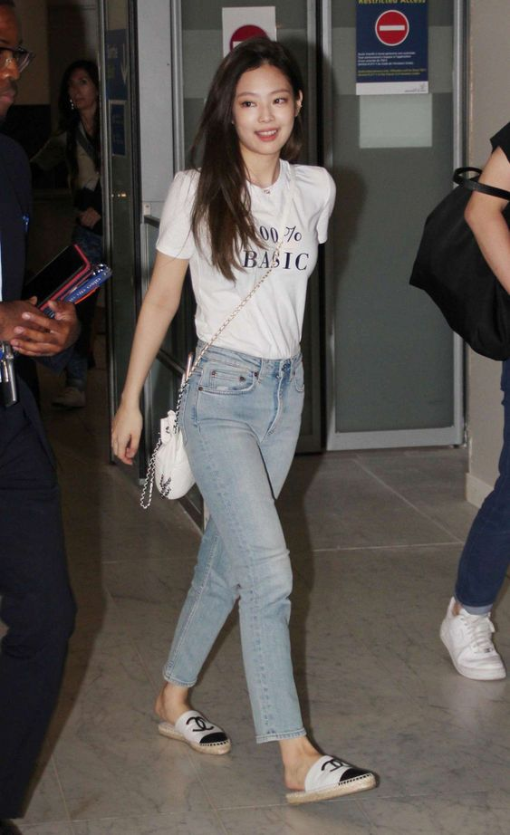"""In this outfit Jennie is wearing a white t-shirt with the text """"100% Basic"""", straight leg jeans, and Chanel espadrille mules"""